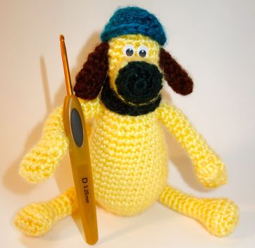 Crocheted toy dog Bitzer, character from Shaun the Sheep